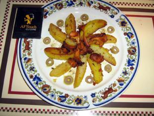 Pommes d'or rissolées et girolles