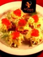 Blinis de radis noirs et oeufs de saumon fumé