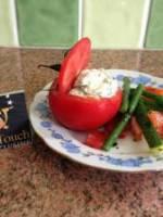 Tomates fourr�es au ch�vre frais et huile d'olive au basilic